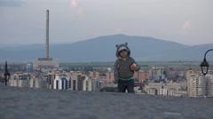 Adorable little child walking, move away, block of flats, urban scene 4K Stock Footage