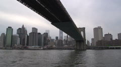 Brooklyn bridge and Freedom tower from the East river , New York City, USA Stock Footage