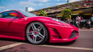 Stock Video Footage of Red Ferrari in slow motion low angle passing by