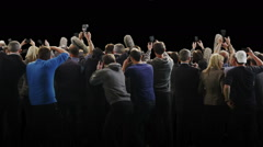 Paparazzi crowd fighting to get the best picture on black background Stock Footage