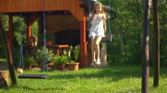 Child on swing in slow motion - stock footage