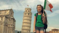 The Leaning Tower of Pisa and child tourist waving flag frantically Stock Footage
