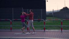 Joggers hit high five after run in city, super slow motion, shot at 240fps HD Stock Footage