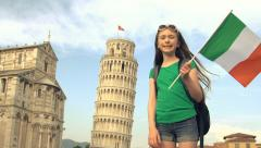 The Leaning Tower of Pisa with child tourist waving Italian flag - slow motion Stock Footage