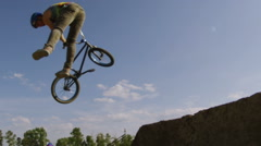 Slow Motion BMX crash - Tailwhip on a dirt Jump - stock footage