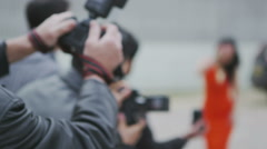 Glamorous model poses for the cameras as paparazzi fight to get the best picture - stock footage