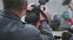 Glamorous model poses for the cameras as paparazzi fight to get the best picture Stock Footage
