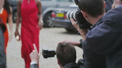 Glamorous models pose for the cameras as paparazzi fight to get the best picture Stock Footage