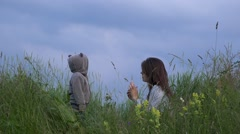 Attractive mother and little son together on peak hill, blue sky Stock Footage