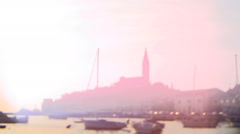 Lens whacked European harbor and town Stock Footage