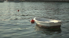 Boat bobbing in the harbor in slow motion Stock Footage