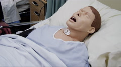 Healthcare Training - Medical dummy and nursing students Stock Footage