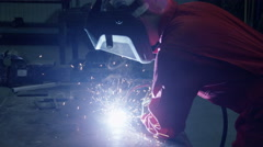 Worker welding in slow motion Stock Footage