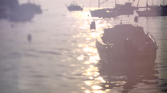 Boats in harbor at sunset - dreamy and lens whacked - stock footage