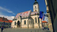 Tilt down to beautiful European church - St Marks - stock footage