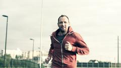 Young man jogging in the city HD Stock Footage