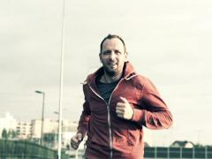 Young man jogging in the city NTSC Stock Footage