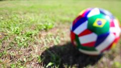 Giving a kick to a Brazil ball on a play ground. - stock footage