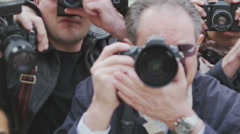 Paparazzi crowd fighting to get the best picture Stock Footage