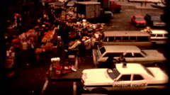 1970s Farmers market in Boston street and cars police Haymarket crowd Stock Footage