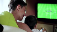 Teen and child playing with game at home (back view) Stock Footage