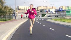 Young woman jogging in the city  HD Stock Footage