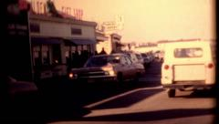 Cars driving on water street plymouth 1970s people walking vintage film historic Stock Footage