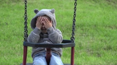 Funny child playing hide and seek, smiling boy balancing in a rocking chair Stock Footage