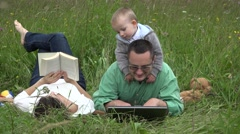 Perfect family, mother reading, father searching, happy baby playing 4K Stock Footage