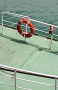 Life belt with buoy attached. Stock Photos