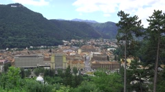 Car moving fast on the road on mountain city, up view perspective, time lapse 4K - stock footage