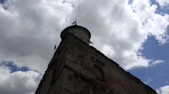 White fluffy sky on blue sky over an old fortress Stock Footage