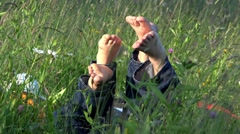 Couple soles and kid together in nature, happy family in waving green grass Stock Footage