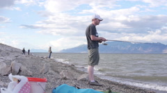 Fishing on shore Stock Footage