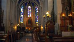 Interior of a Roman Catholic Church with stained glass windows - stock footage
