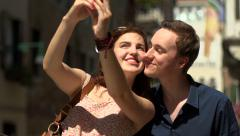 Young couple take selfie on a Venice street Stock Footage