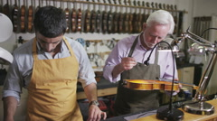 Craftsmen in their workshop, making and restoring violins - stock footage