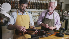 Stock Video Footage of Craftsmen in their workshop, making and restoring violins