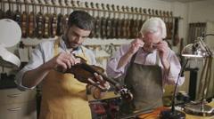 Craftsmen in their workshop, making and restoring violins Stock Footage