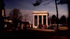 Pan of Plymouth Rock 1970s people street and cars vintage film historic Stock Footage