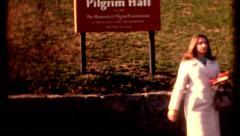 Pilgrim Hall sign people walking around 1970s vintage film historic Stock Footage