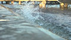 High tide splashes against Venice steps - slow motion - stock footage