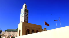 Great mosque of hassan II and moroccan flag Stock Footage