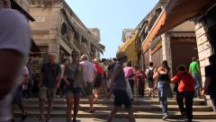 Tourists walk across Rialto Bridge, Venice, Italy - stock footage