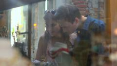 Young couple looking in jewelry shop window in Venice - stock footage