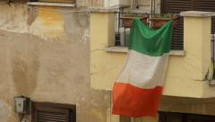 Italian Flag hanging from balcony - Slow Motion - stock footage