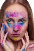 Stock Photo of gorgeous young girl with colour powder on face