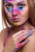 beautiful girl with colour powder on face - stock photo