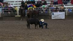 Rodeo night muddy rain steer wrestling failure 4K Stock Footage