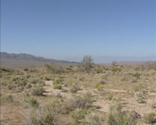Colorado Desert in southeast California + pan landscape, mountain crests Stock Footage